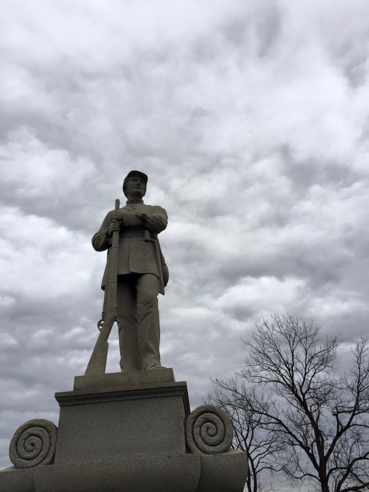 A silent soldier, cast in stone, overlooks Antietam Battlefield