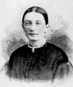 A black and white photograph of a young nurse