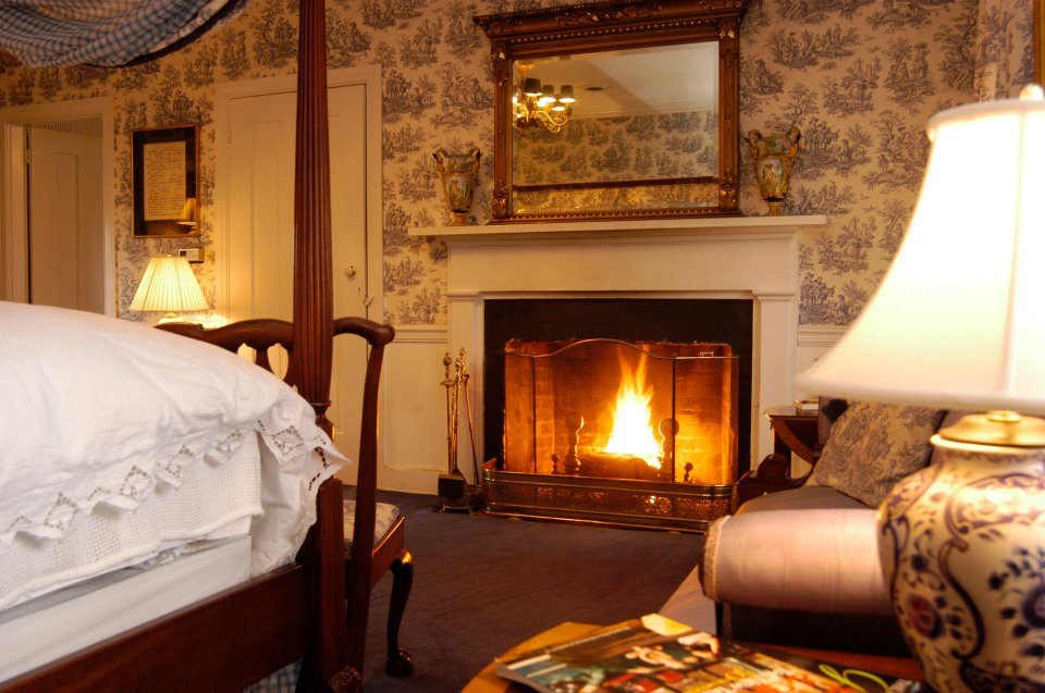 A roaring fire warms a room at the Antrim Country House Hotel