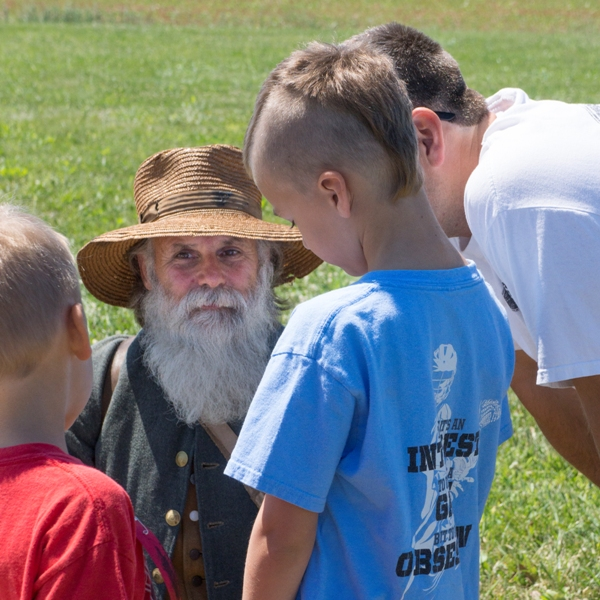 A young boy meets a living historian at Monocacy National Battlefield