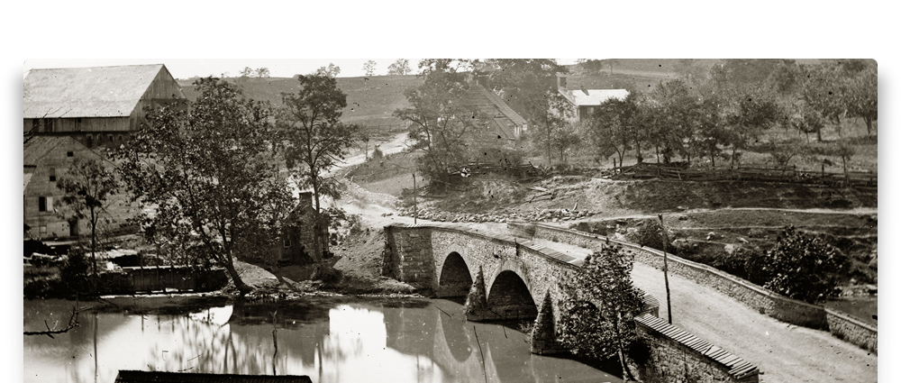 A historic photo of the Newcomer House and Barn along Antietam Creek